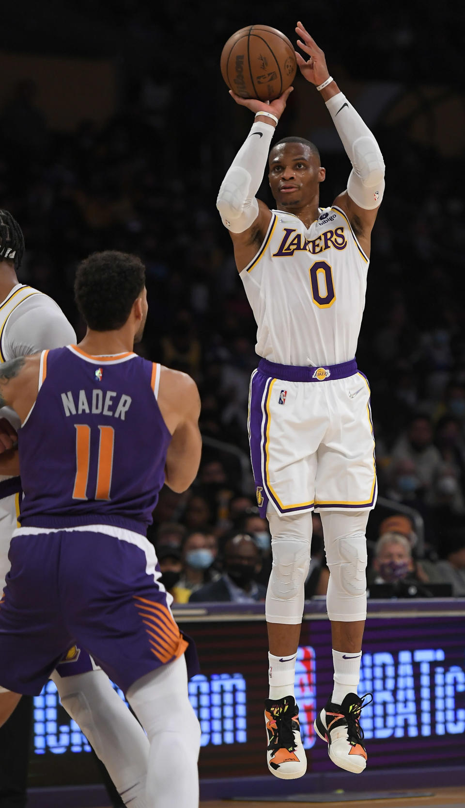 Phoenix Suns forward Abdel Nader (11) looks on as Los Angeles Lakers guard Russell Westbrook (0) shoots the ball in the second half of a preseason NBA basketball game in Los Angeles, Sunday, Oct. 10, 2021. (AP Photo/John McCoy)