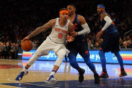 Dec 16, 2017; New York, NY, USA; New York Knicks small forward Michael Beasley (8) drives against Oklahoma City Thunder point guard Russell Westbrook (0) and forward Carmelo Anthony (7) during the third quarter at Madison Square Garden. Mandatory Credit: Brad Penner-USA TODAY Sports