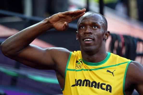 LONDON, ENGLAND - AUGUST 05:  Usain Bolt of Jamaica salutes te crowd during the Men's 100m Semifinal on Day 9 of the London 2012 Olympic Games at the Olympic Stadium on August 5, 2012 in London, England.  (Photo by Cameron Spencer/Getty Images)