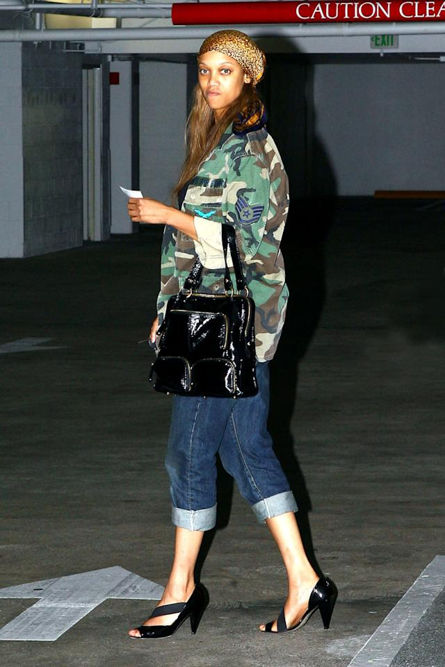 "Tyra, you are no longer in the running to become America's Next Top Trendsetter. Pairing a cheetah print headscarf with a camo jacket, cuffed denim clam diggers, and strappy black heels? Even Miss J wouldn't approve! Pare/<a href=""http://www.x17online.com"" target=""new"">X17 Online</a> - March 17, 2009"