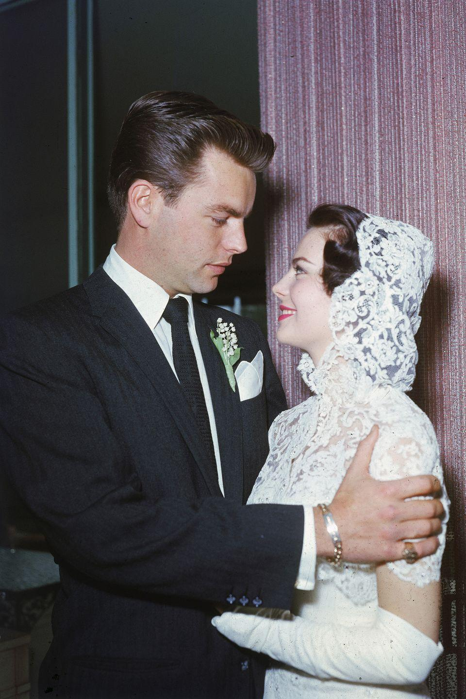 <p>Natalie Wood wore a unique hooded lace headpiece for her 1957 nuptials to Robert Wagner in Scottsdale, Arizona. The couple was married for four years before divorcing, but eventually remarried in 1972. </p>