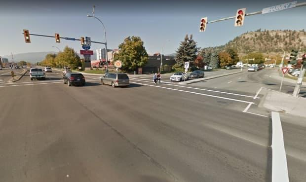 A 15-year-old girl has died and two people are in hospital after a vehicle making a left hand turn from Harvey Avenue onto Dilworth Drive in Kelowna, B.C., collided with a motorcyle which then struck two pedestrians. (Google Maps - image credit)
