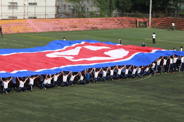 <p>In this Sept. 26, 2017, photo, a student flag team practices a performance waving red, white and blue banners to form th North Korea national flag at a Tokyo Korean high school in Tokyo. Many third- and fourth-generation descendants of Koreans brought to Japan during the imperialist years before and during World War II remain loyal to their roots. Families send children to private schools that favor North Korea and teach the language, culture and history of their ancestry. Despite recent North Korean missile launches and nuclear tests, students say they take pride and view their community as a haven from the discrimination they face from ethnic Japanese. (AP Photo/Eugene Hoshiko) </p>