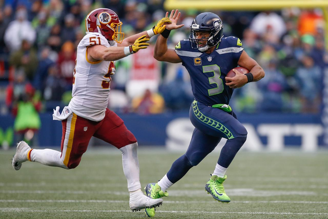 <p>Quarterback Russell Wilson #3 of the Seattle Seahawks rushes against linebacker Will Compton #51 of the Washington Redskins at CenturyLink Field on November 5, 2017 in Seattle, Washington. The Redskins beat the Seahawks 17-14. (Photo by Otto Greule Jr/Getty Images) </p>