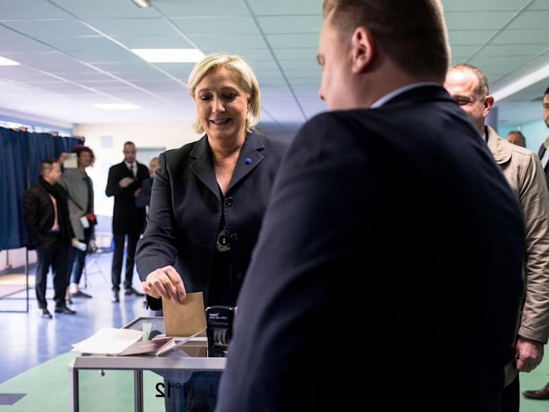 As voting drew to a close in round one of a bitterly contested presidential race, polling suggested Le Pen and centrist Emmanual Macron were in the lead: Getty