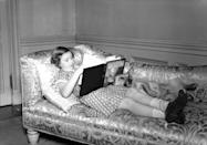 <p>Princess Margaret was captured reading <em>The Children of The New Forest</em> by Captain Marryat at Windsor Castle while the family corgi, Jane, cuddled next to her. </p>