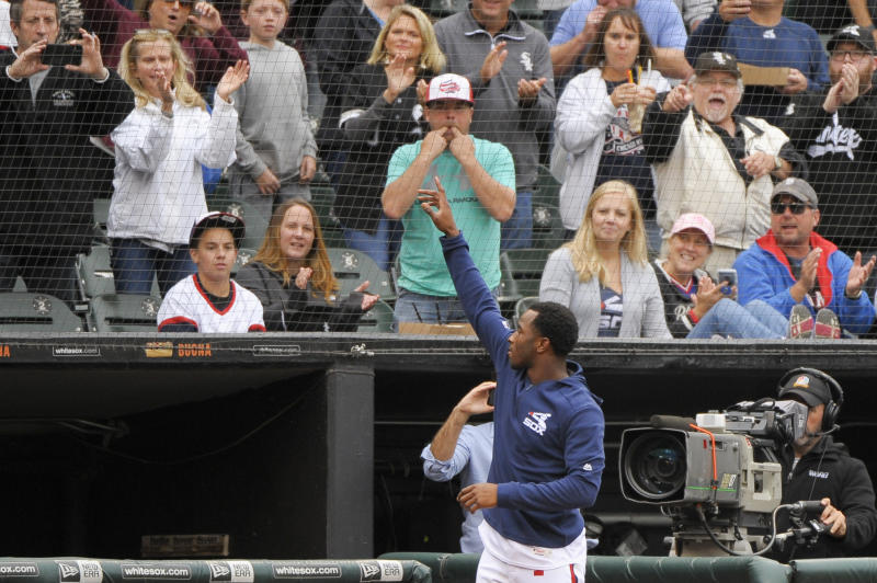 Chicago White Sox's Tim Anderson (7) comes out of the dugout and waves to fans after a baseball game against the Detroit Tigers Sunday, Sept. 29, 2019, in Chicago. Anderson, who is attempting to become the third White Sox player to win a batting title, went 0 for 2 with two walks in the second game after sitting out the opener. (AP Photo/Mark Black)