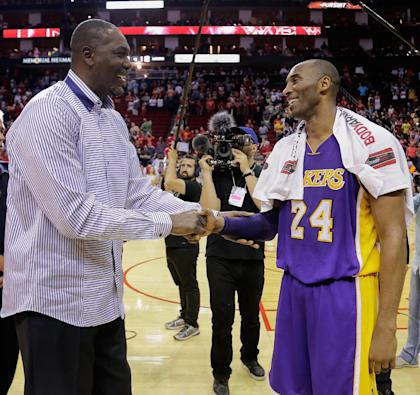 Former Rockets center Hakeem Olajuwon congratulates Kobe Bryant. (Getty Images)