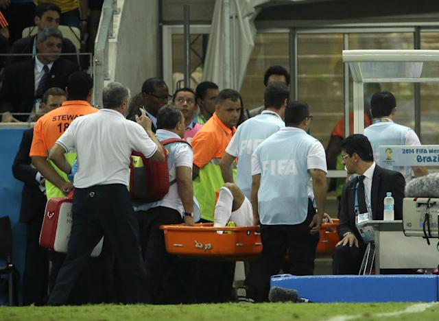 Brazil's Neymar is taken away on a stretcher after being injured during the World Cup quarterfinal soccer match between Brazil and Colombia at the Arena Castelao in Fortaleza, Brazil, Friday, July 4, 2014. (AP Photo/Hassan Ammar)
