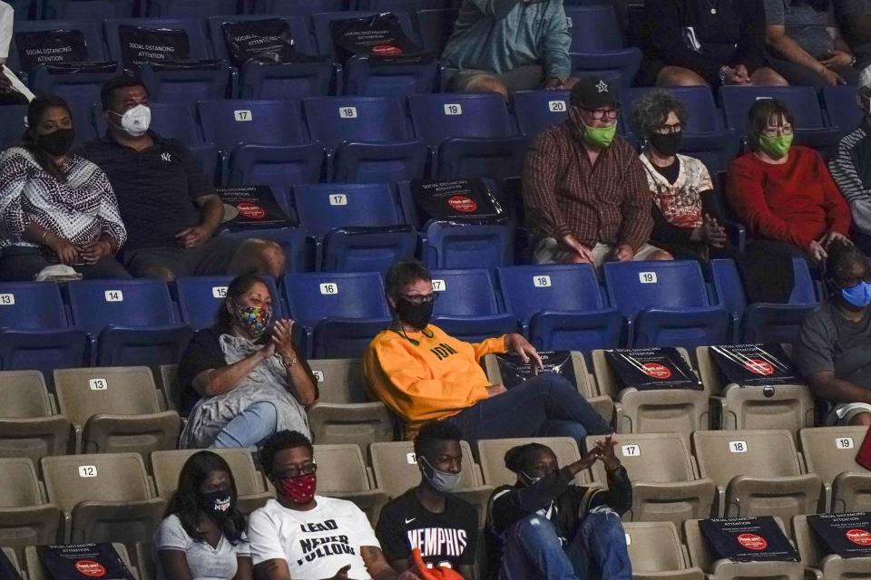 A limited number of fans watch during the first half of an NCAA college basketball game between UConn and Iowa in the Sweet 16 round of the Women's NCAA tournament Saturday, March 27, 2021, at the Alamodome in San Antonio. (AP Photo/Morry Gash)