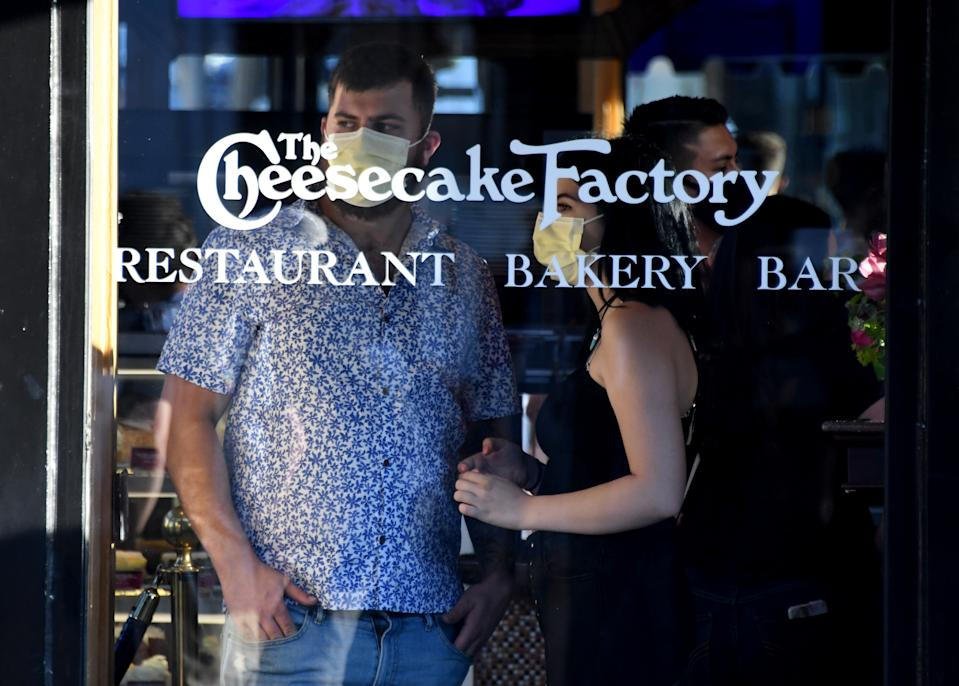 PASADENA, CA - JUNE 12:  Patrons of Cheesecake Factory looks on as demonstrators protest along Colorado Blvd. during a Black Lives Matter protest after the death of George Floyd, a black man who was in police custody in Minneapolis in Pasadena on Friday, June 12, 2020. (Photo by Keith Birmingham/MediaNews Group/Pasadena Star-News via Getty Images)