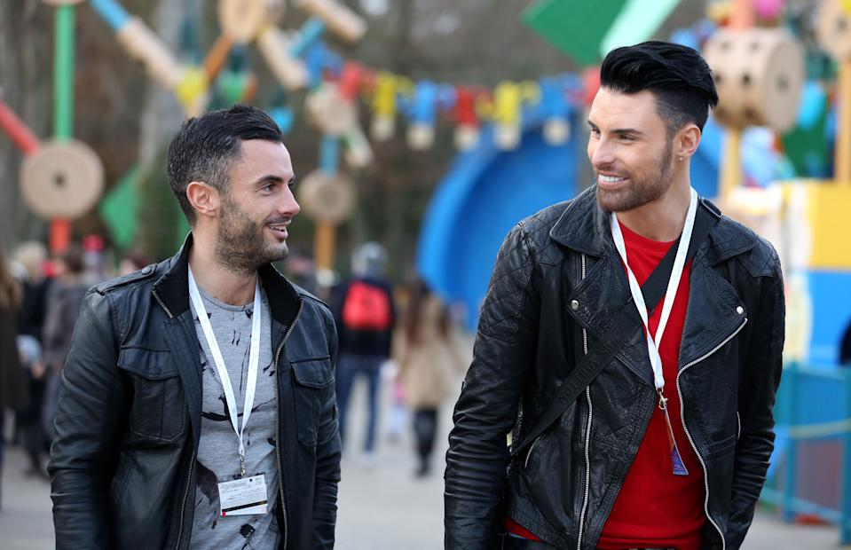 Rylan Clark (centre) and his boyfriend Dan Neal (left) walk together as they accompany children from the Carers Trust and a community hub in a deprived area of east London on a charity day trip to Disneyland Paris.   (Photo by Chris Radburn/PA Images via Getty Images)