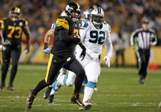 Pittsburgh Steelers quarterback Ben Roethlisberger (7) scrambles past Carolina Panthers defensive tackle Vernon Butler (92) during the second half of an NFL football game in Pittsburgh, Thursday, Nov. 8, 2018. (AP Photo/Keith Srakocic)