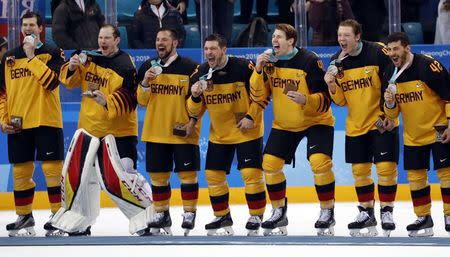 Ice Hockey - Pyeongchang 2018 Winter Olympics - Men Final Match - Olympic Athletes from Russia v Germany - Gangneung Hockey Centre, Gangneung, South Korea - February 25, 2018 - German team players celebrate with their silver medals.