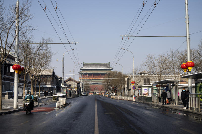 A nearly empty road leads to the landmark Drum Tower in Beijing on Friday, Feb. 7, 2020. (Giulia Marchi/The New York Times)