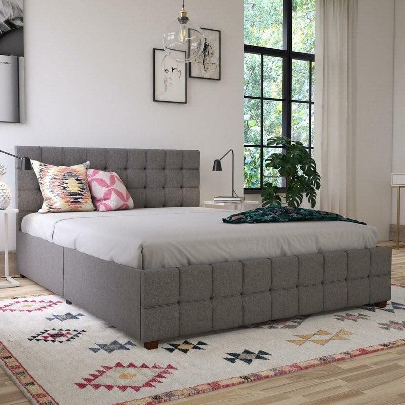 <p>You can't go wrong with this classic <span>Elizabeth Upholstered Storage Platform Bed</span> ($510, originally $900).</p>