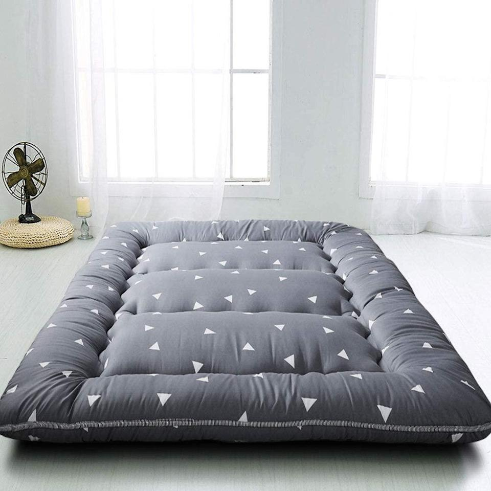 "<h3><a href=""https://amzn.to/2Zm45n1"" rel=""nofollow noopener"" target=""_blank"" data-ylk=""slk:Maxyoyo Japanese Floor Futon Mattress"" class=""link rapid-noclick-resp"">Maxyoyo Japanese Floor Futon Mattress</a></h3><br><strong>When you don't have a guest room (let alone room for guests)</strong>: Fold up and tuck this twin-sized, traditional Japanese futon-style mattress underneath your bed to use as a pull-out sleep space for your guests in a pinch.<br><br><strong>MAXYOYO</strong> Grey Triangle Japanese Floor Futon Mattress, $, available at <a href=""https://amzn.to/2YMa9pS"" rel=""nofollow noopener"" target=""_blank"" data-ylk=""slk:Amazon"" class=""link rapid-noclick-resp"">Amazon</a>"
