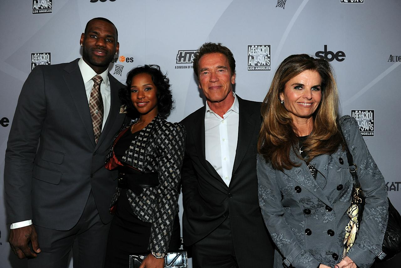 LOS ANGELES, CA - FEBRUARY 18:  NBA player LeBron James of the Miami Heat, Savannah Brinson, Former California Goveror Arnold Schwarzenegger, and Maria Shriver attend After-School All-Stars (ASAS) Hoops Heroes Salute VIP after party at Katsuya, LA Live on February 18, 2011 in Los Angeles, California.  (Photo by Alberto E. Rodriguez/Getty Images for ASAS)
