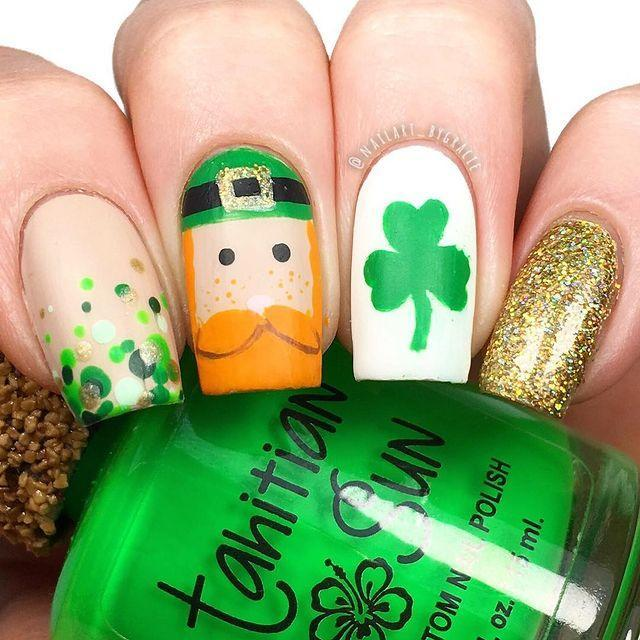 "<p>The most striking (not to mention, adorable) nail is the middle finger, which displays a leprechaun sporting a hat and full beard. Complemented by glittery gold, a clover and green dotted nails, this is for the St. Patrick's Day superfan. </p><p><a href=""https://www.instagram.com/p/BgXh-ryBMOP/&hidecaption=true"" rel=""nofollow noopener"" target=""_blank"" data-ylk=""slk:See the original post on Instagram"" class=""link rapid-noclick-resp"">See the original post on Instagram</a></p>"