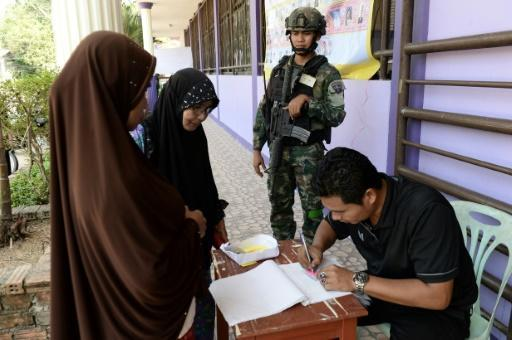 A soldier stands guard at a polling station in Narathiwat, in Thailand's 'Deep South' which has been in the grip of a low-level insurgency for more than a decade