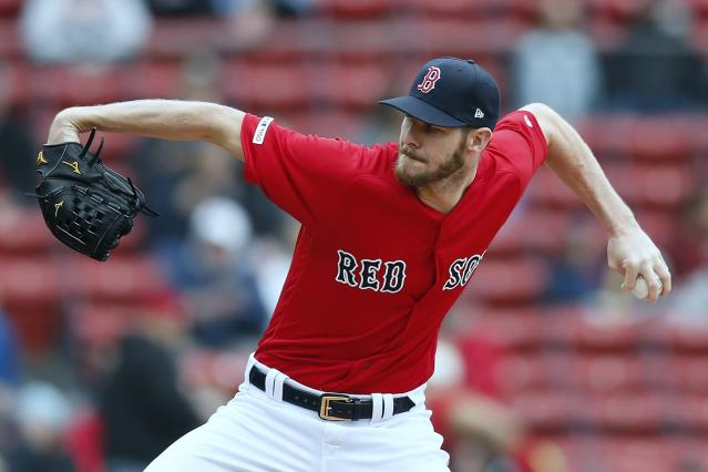 Boston Red Sox's Chris Sale pitches during the first inning of the first game of a baseball doubleheader against the Detroit Tigers in Boston, Tuesday, April 23, 2019. (AP Photo/Michael Dwyer)