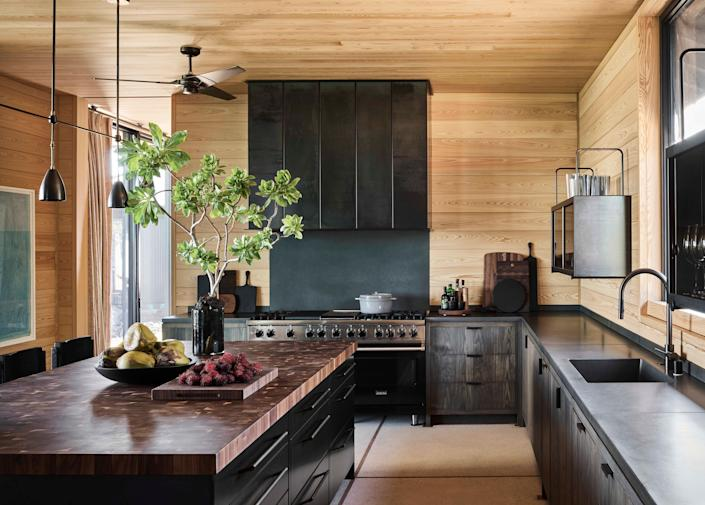 The homeowners' passion for cooking and restaurants informed the chef's kitchen, kitted out with convection ovens, a six-burner stove, and on-demand sparkling water. Slender pendant lamps by Apparatus Studio and swan-like Dornbracht fixtures are graceful counterpoints to the Grothouse walnut butcher-block island top and poured-concrete counters by Sonoma Cast Stone, brawny elements to match the mountain views.