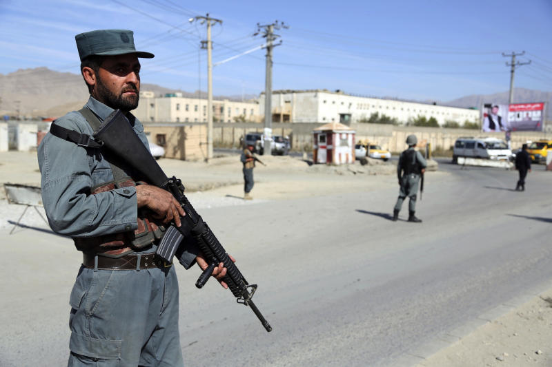 In this Wednesday Oct. 17, 2018, photo, Afghan Police stand guard at a checkpoint ahead of parliamentary elections, in Kabul, Afghanistan. The elections are being held Saturday despite deep security concerns and ongoing fighting in as many as 20 out of the country's 34 provinces. More than 50,000 members of the Afghan security forces will be deployed to secure polling stations. (AP Photo/Rahmat Gul)