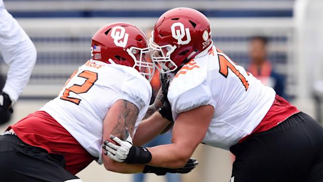 Oklahoma's O-Line provided protection for two successive Heisman Trophy winners, and next week four of its members will head to the NFL.