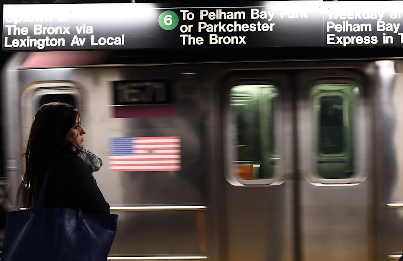 A woman waits to catch her train in a subway station in New York on September 25, 2014. Iraq's Prime Minister Haider al-Abadi, who is attending the 69th session of the United Nations General Assembly in New York, said his country's intelligence operation has uncovered a plot for an attack on subway systems in the United States and Paris. AFP PHOTO/Jewel Samad (Photo credit should read JEWEL SAMAD/AFP via Getty Images)