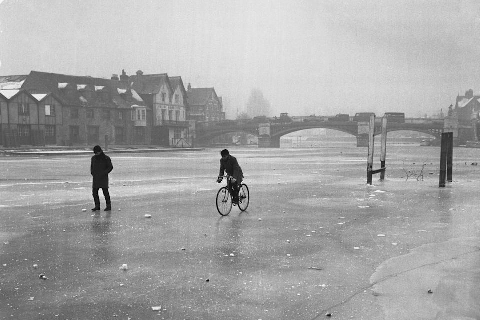 A man riding a bike on the frozen River Thames in 1963. (PA)