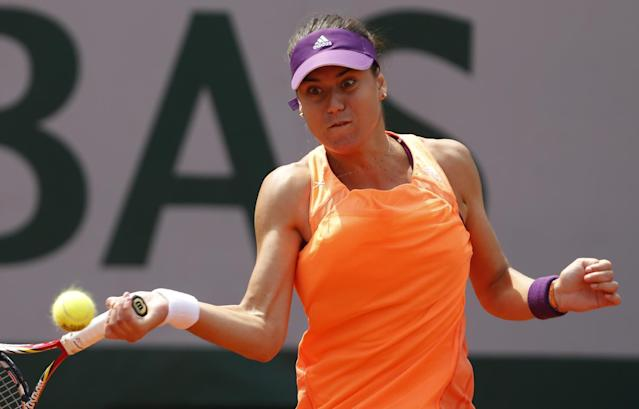 Romania's Sorana Cirstea returns the ball to Serbia's Jelena Jankovic during their third round match of the French Open tennis tournament at the Roland Garros stadium, in Paris, France, Saturday, May 31, 2014. (AP Photo/Darko Vojinovic)