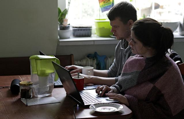 Employers and governments and encouraging workers to work from home to avoid contracting coronavirus as the pandemic spreads across the world. (Eloy Martin/Reuters)