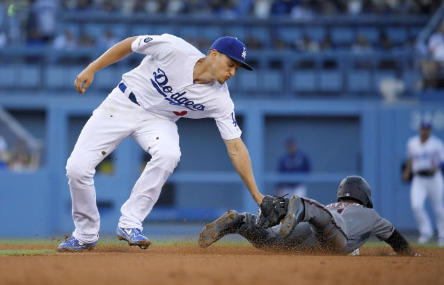 Arizona Diamondbacks' Jarrod Dyson, right, is tagged out by Los Angeles Dodgers shortstop Corey Seager as he tries to steal second during the fourth inning of a baseball game Saturday, Aug. 10, 2019, in Los Angeles. (AP Photo/Mark J. Terrill)