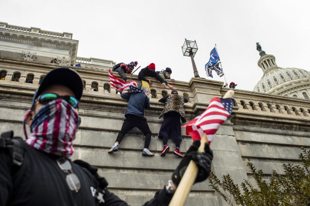 Protesters climb the US Capitol walls in Washington on Jan 6 2021 as hundreds of people in a pro-Trump mob breached the building Jason AndrewThe New York Times