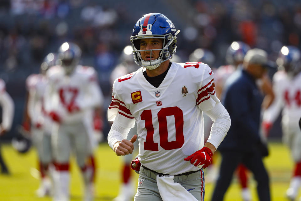 FILE - In this Nov. 24, 2019, file photo, New York Giants quarterback Eli Manning (10) is shown before an NFL football game against the Chicago Bears, in Chicago. Giants quarterback Daniel Jones was kept out of practice Wednesday, Dec. 4, 2019, with a high right ankle sprain, and coach Pat Shurmur says Eli Manning very likely will start Monday night against the Philadelphia Eagles. Shurmur adds that Manning could very well be the starter for the rest of the season. (AP Photo/Paul Sancya, File)