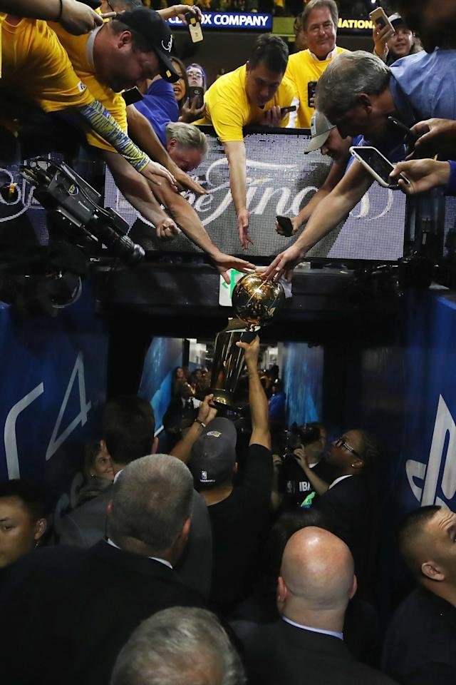<p>Stephen Curry #30 of the Golden State Warriors carries off the Larry O'Brien Championship Trophy after defeating the Cleveland Cavaliers 129-120 in Game 5 to win the 2017 NBA Finals at ORACLE Arena on June 12, 2017 in Oakland, California. </p>