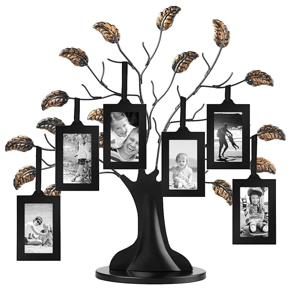 <p>The <span>Americanflat Bronze Family Tree Frame</span> ($23) holds six family photos.</p>
