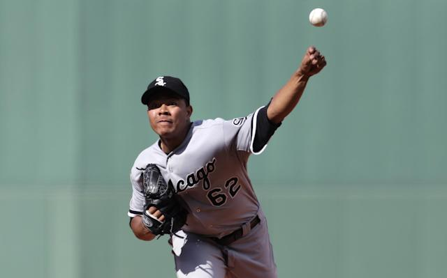 Chicago White Sox starting pitcher Jose Quintana delivers against the Boston Red Sox during the first inning of a baseball game at Fenway Park in Boston, Thursday, July 10, 2014. (AP Photo/Charles Krupa)