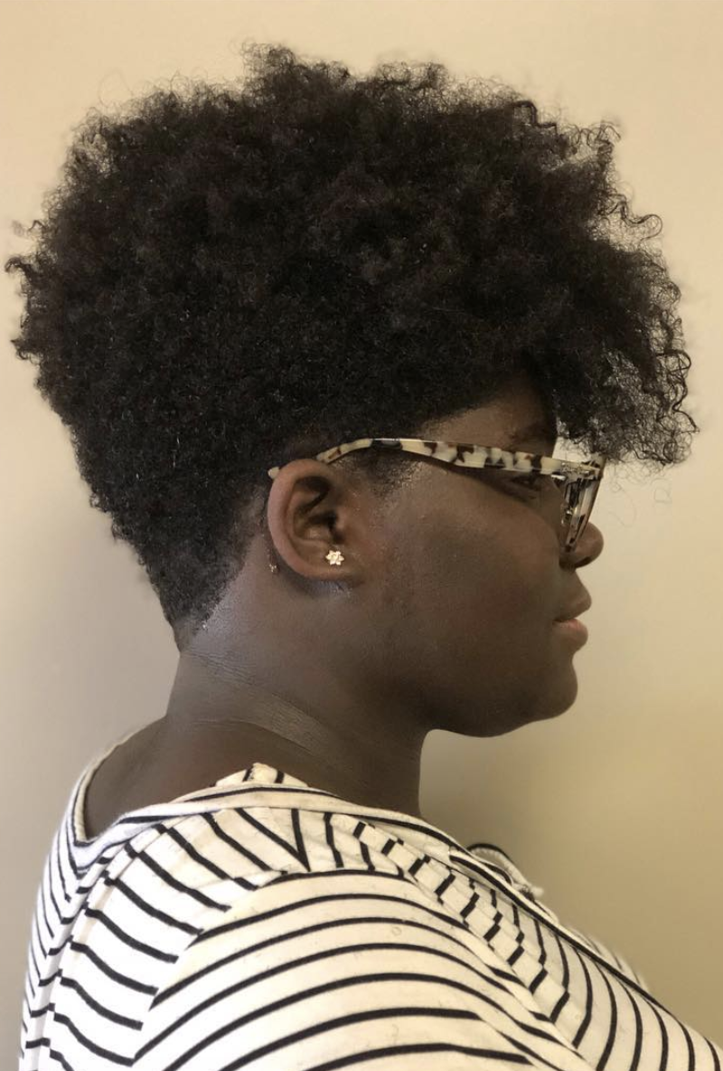 """""""The tapered cut allows shorter sides and clean lines and leaves massive length in the top to achieve popular natural hairstyles such as twist-outs, rods, coils, and double-strand twists,"""" says TaKeisha Berry-Brooks, hairstylist and founder of <a href=""""http://anaturalaffair.com/"""" rel=""""nofollow noopener"""" target=""""_blank"""" data-ylk=""""slk:A Natural Affair Beauty Lounge"""" class=""""link rapid-noclick-resp"""">A Natural Affair Beauty Lounge</a> in Memphis. """"Most are also experimenting with vivid colors to complete the edgy look."""""""