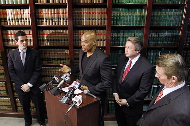Former Kansas City Chiefs linebacker Chris Martin, second from left, talks about his football injures as he and his attorney Ken McClain, second from right, talk about a lawsuit filed today against the Kansas City Chiefs organization during a news conference in Independence, Mo, Tuesday, Dec. 3, 2013. The lawsuit on behalf of five former Kansas City Chiefs players for failing to disclose the dangers of competing after suffering head injuries. (AP Photo/Colin E Braley)