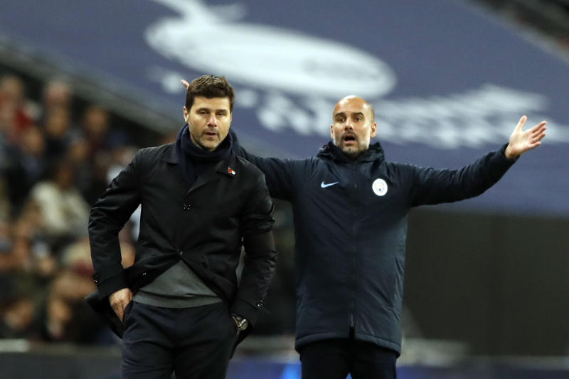 Manchester City coach Pep Guardiola, right, gesture on the sidelines next to Tottenham manager Mauricio Pochettino during the English Premier League soccer match between Tottenham Hotspur and Manchester City at Wembley stadium in London, England, Monday, Oct. 29, 2018. (AP Photo/Alastair Grant)