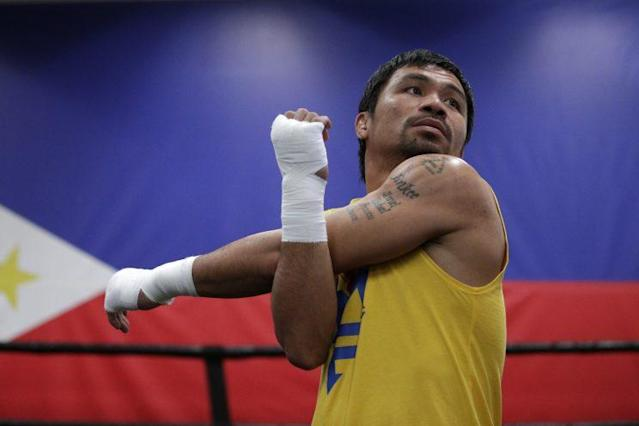 Manny Pacquiao says he'll meet Amir Khan in the ring on April 23. (Getty)