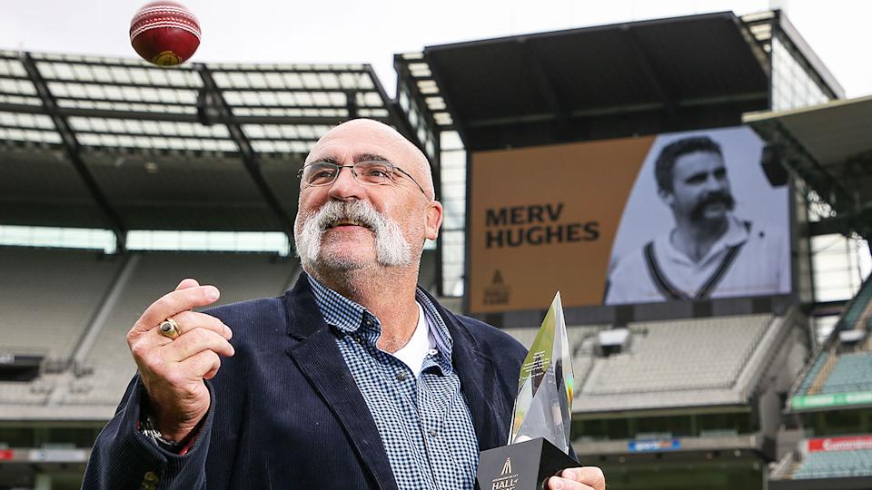 Merv Hughes is seen here accepting his Hall of Fame honour at the MCG.
