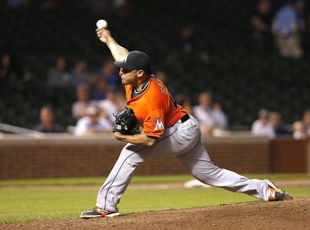 Miami Marlins relief pitcher A.J. Ramos delivers during the ninth inning of the Marlins' 6-2 win over the Chicago Cubs in a baseball game Tuesday, Sept. 3, 2013, in Chicago. (AP Photo/Charles Rex Arbogast)
