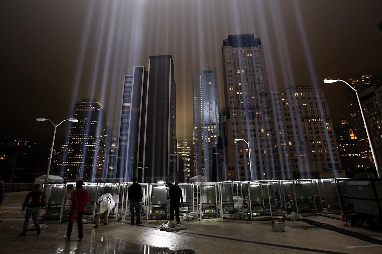NEW YORK, NY - SEPTEMBER 07:  Workers adjust beams of the Tribute in Lights ahead of the tenth anniversary of the September 11 terrorist attacks on September 7, 2011 in New York City. The Tribute in Light is comprised of 88 7000 watt searchlights that beam into the sky near the site of the World Trade Center in remembrance of the September 11 attacks.  (Photo by Justin Sullivan/Getty Images)