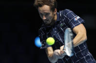 Daniil Medvedev of Russia plays a return to Diego Schwartzman of Argentina during their singles tennis match at the ATP World Finals tennis tournament at the O2 arena in London, Friday, Nov. 20, 2020. (AP Photo/Frank Augstein)