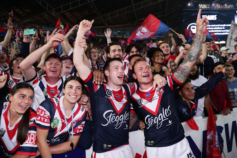 Luke Keary (L) and Jake Friend (R) of the Roosters celebrate victory with fans after the 2019 NRL Grand Final. (Photo by Matt King/Getty Images)