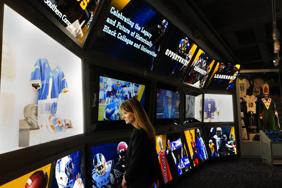 College Football Hall of Fame chief executive officer Kimberly Beaudin looks over their new exhibit dedicated to historically black colleges and universities, Thursday, Sept. 2, 2021, in Atlanta. (AP Photo/John. Bazemore)