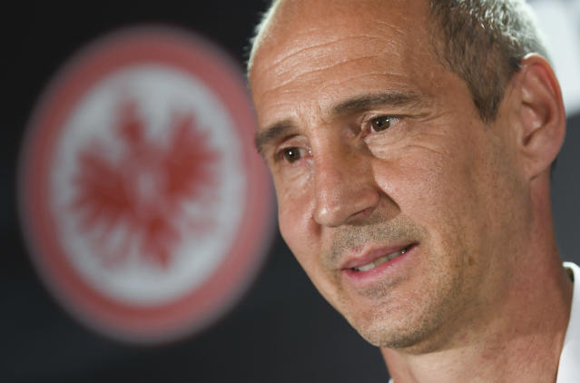 Adi Huetter from Austria poses for the media after his presentation as the new head coach of the German First Division, Bundesliga, soccer team 'Eintracht Frankfurt' in Frankfurt, Germany, Wednesday, May 30, 2018. (Arne Dedert/dpa via AP)
