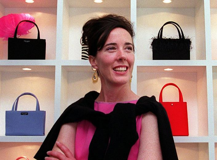"""Designer Kate Spade, seen here with her handbags in 1999, <a href=""""https://www.huffingtonpost.com/entry/kate-spade-dead-dies_us_5b16b559e4b0599bc6dd5eb2?4at"""" rel=""""nofollow noopener"""" target=""""_blank"""" data-ylk=""""slk:died at age 55"""" class=""""link rapid-noclick-resp"""">died at age 55</a> on June 5, 2018."""